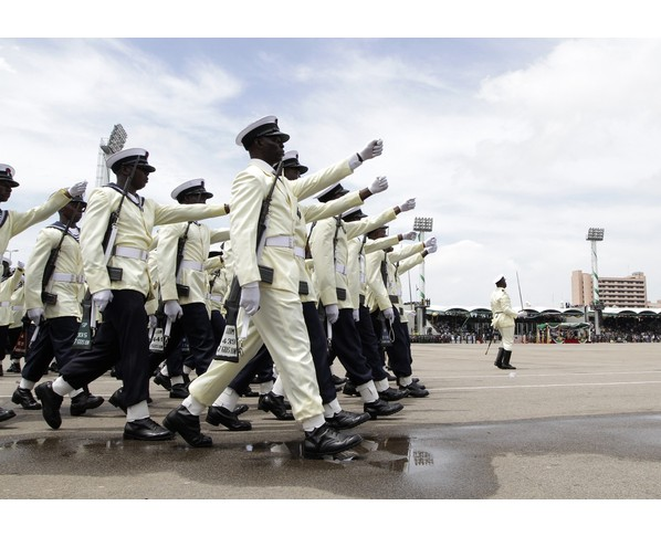 Members of the Nigerian Navy march at a parade marking the 50th anniversary of the country's independence in Abuja