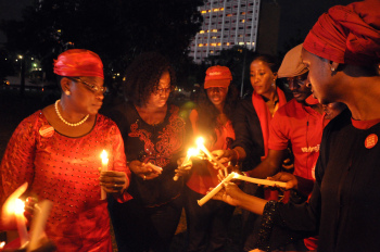 Campaigners for the release of abducted Chibok Schoolgirls light up candle lights representing the number of the missing girls on October 12, 2014 during a vigil in Abuja to mark six-month anniversay of the kidnap by the Boko Haram Islamists at Chibok town. AFP PHOTO/STRINGER