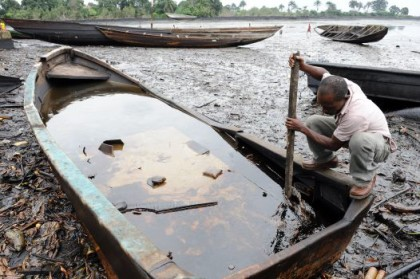 A Fisherman at the site of an oil spill in Niger Delta