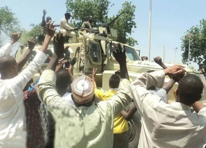 Nigerian troops being hailed by the Civilians in Borno State after successfully destroying the assault on the community by Members of Boko Haram