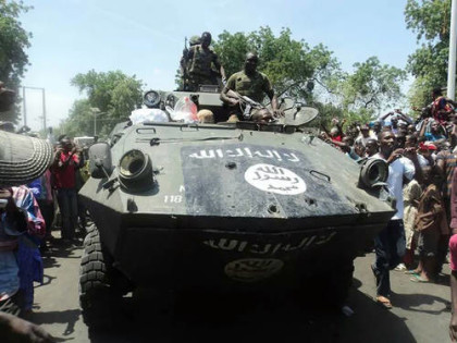 Nigerian troops parading an Armored Personnel Carrier(APC) captured from Boko Haram during the fight for Konduga, Borno State