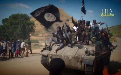 Boko Haram fighters parading on a tank in an unidentified town in North-East Nigeria