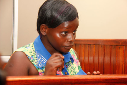 The 22-year-old Jolly Tumuhiirwe in the dock at City Hall Court on Monday. She pleaded guilty to the charges of torture and asked for forgiveness for her actions. Photo by Abubaker Lubowa
