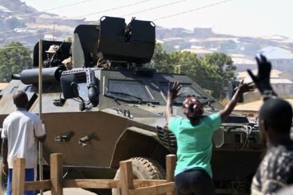 Appreciative Nigerians wave to troops inside an Otokar Cobra APC in a conflict zone(Photo: beegeagle.wordpress.com)