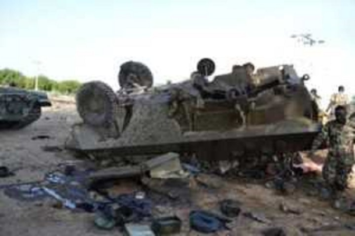 A Boko Haram Armour Carrier turned over by Nigerian military Tank