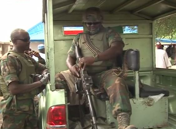 Nigerian Soldier with a machine-gun stationed in the North-East