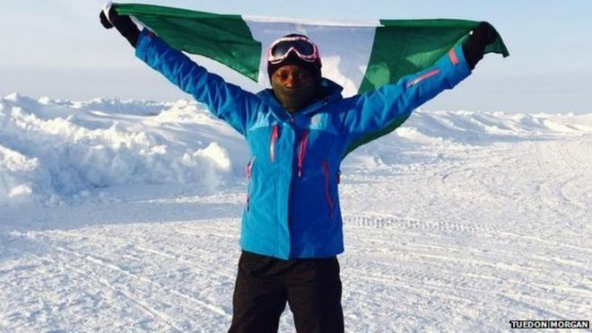 Tuedon Morgan, poses with the Nigerian Flag at the North Pole