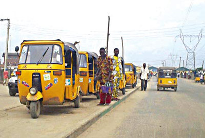 A tricycle(keke NAPEP/ Keke Marwa) loading in Lagos, Nigeria