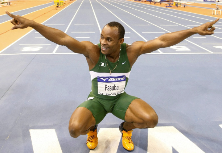 Nigeria's Olusoji A. Fasuba celebrates after winning the men's 60m final at the 12th IAAF World Indoor Athletics Championship in Valencia March 7, 2008.     REUTERS/Eric Gaillard (SPAIN) - RTR1Y0MO