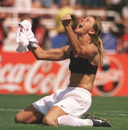 In this July 10, 1999 photo, United States' Brandi Chastain celebrates after kicking the game-winning overtime penalty shootout goal against China during the Women's World Cup Final at the Rose Bowl in Pasadena, Calif. LACY ATKINS / AP