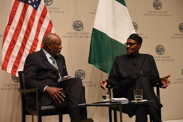 Amb. Johnnie Carson with President Buhari in dialogue and responding to audience questions  @ USIP