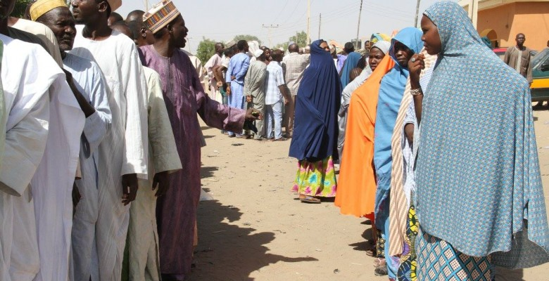 IDPs on a queue to receive relief items