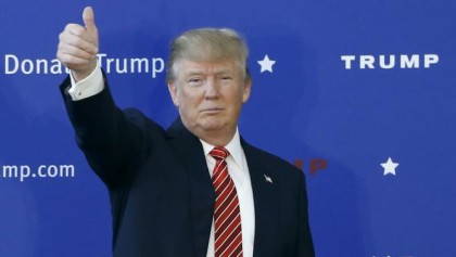 Republican presidential candidate Donald Trump gives a thumbs-up during a campaign stop, Saturday, Jan. 16, 2016, in Portsmouth, N.H. (AP Photo/Matt Rourke)