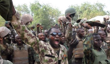 Brave Nigerian soldiers celebrate following the routing of Boko Haram fighters in the North east.