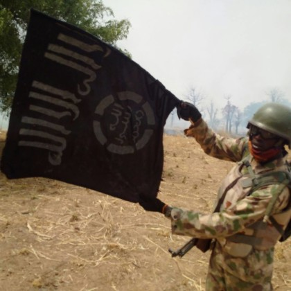 Nigerian Soldier Holding Boko Haram Flag After destroying BH Camp At Alagarno Forest