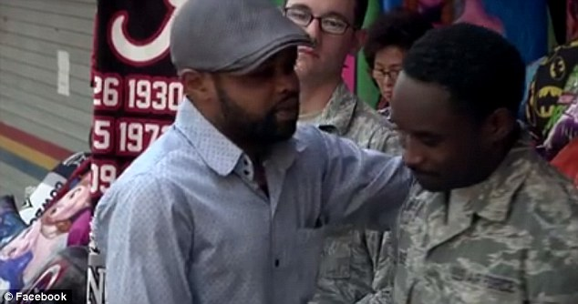 Enyioko (pictured hugging the soldiers) said he was overwhelmed with gratitude to the airmen