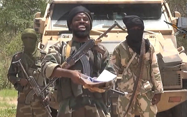 A screengrab taken on July 13, 2014 from a video released by Boko Haram shows the leader of the Nigerian Islamist extremist group Boko Haram, Abubakar Shekau (C). The head of Nigeria's Boko Haram Islamists, Abubakar Shekau.