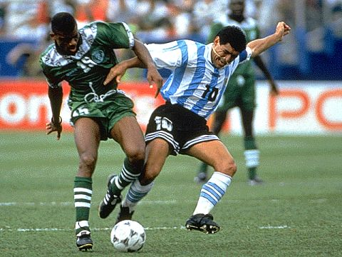 Sunday Oliseh tackling Argentina's Maradona at the world cup