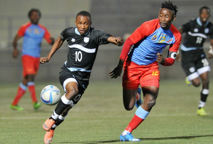Bodrick Muselenge of DR Congo challenges Onkabetse Makgantai of Botswana during the 2016 Cosafa Cup Semifinal match between Botswana and DR Congo at Sam Nujoma Stadium in Windhoek Namibia on 22 June, 2016 ©Muzi Ntombela/BackpagePix(PHOTO: COSAFA)