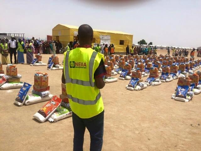 NEMA Official at an IDP Camp(PHOTO: NEMA)