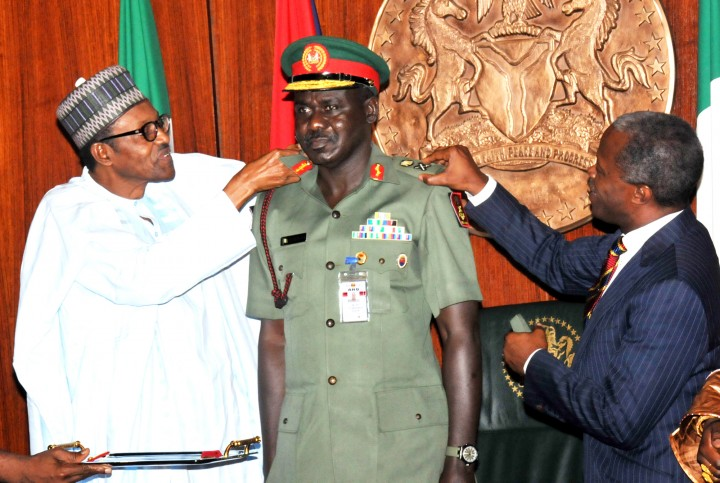 Buratai, middle being decorated by President Buhari, left and VP Osinbajo (PHOTO: NAN)