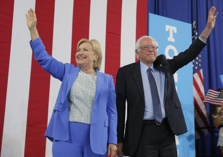 Democratic U.S. presidential candidate Hillary Clinton and Sen. Bernie Sanders stand together during a campaign rally where Sanders endorsed Clinton in Portsmouth, New Hampshire, U.S., July 12, 2016. (PHOTO: Brian Snyder)