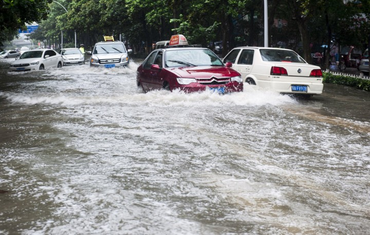 Pic shows:  Scenes of flooding in Ezhou, Hubei. Continuous rainfall in a Chinese city has caused flooding in a football stadium which now resembles a giant swimming pool. Reports said similar freak weather conditions have not been seen for decades, and tens of thousands are now being evacuated from their homes. Heavy storms in the city of Ezhou, in Central China's Hubei Province, have inundated the streets with water and have caused serious disruptions to public transportation. Mingtang Stadium, the city's landmark, is now also full of floodwater, making it look more like a bathtub than football grounds. Reports said it is the first time in 30 years, since the stadium's completion, that it has ever been flooded, with waters covering the pitch and even reaching above the goal at either end. Incredible pictures of the open-roof stadium have since gone viral online, with netizens joking that the stadium seems to hold water quite well. But officials are desperately dealing with the aftermath of one of the wettest summers, with rainfall still continuing to batter the city where 27 people have died and 16 are unaccounted for as a result of the weather. The city's meteorological bureau has issued ongoing storm warnings, with reports saying tens of thousands have been evacuated and relocated. Since the beginning of July at least 14 provinces have reported floods and landslides caused by non-stop rainstorms, which some regions experiencing 300 millimetres of rainfall in just 24 hours. (ends)