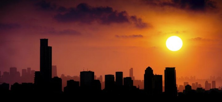 gw-impacts-setting-sun-and-city-skyline