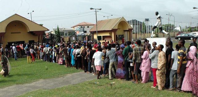 Pic.21. People queue for Lake Rice at the distribution centre in Teslim Balogun Stadium, Surulere in Lagos on Friday (23/12/16). Lake Rice distribution is powered by Lagos and Kebbi states government in collaboration with San Carlos Group incorporated. 9326/23/12/2016/Oladapo Kayode/BJO/NAN