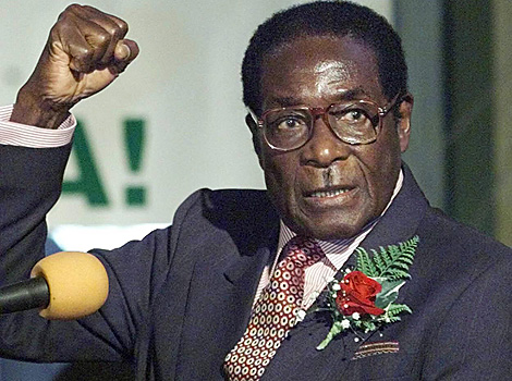 Mugabe says not going anywhere, not dying