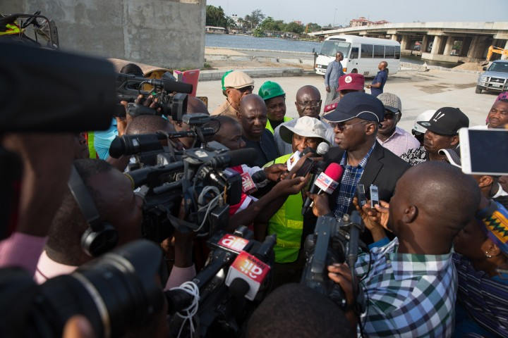 Hon. Minister of Power, Works & Housing, Mr Babatunde Fashola,SAN(left) speaking with Journalists shortly after his inspection tour of the ongoing construction work on the Rehabilitation of Access Road to Apapa/Tin Can Island Port - NNPC Depot (Atlas Cove) including the construction of a new bridge running parallel to the existing bridge from Liverpool Roundabout across Port Novo Creek in Lagos State on Day Three of his inspection tour of Highway Projects in the South West Zone of the country on Saturday 25th, March 2017.