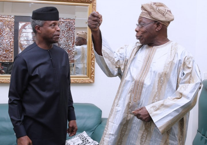 AG PRESIDENT OSINBAJO ATTENDS BIAFRA@50YRS AFTER FORUM. 1A&B. R-L; Former President Chief Olusegun Obasanjo chats with Acting President Yemi Osinbajo at a forum on Biafra 50 Years after held at the Shehu Musa Yar'Adua Centre in Abuja. PHOTO; SUNDAY AGHAEZE. MAY 25 2017