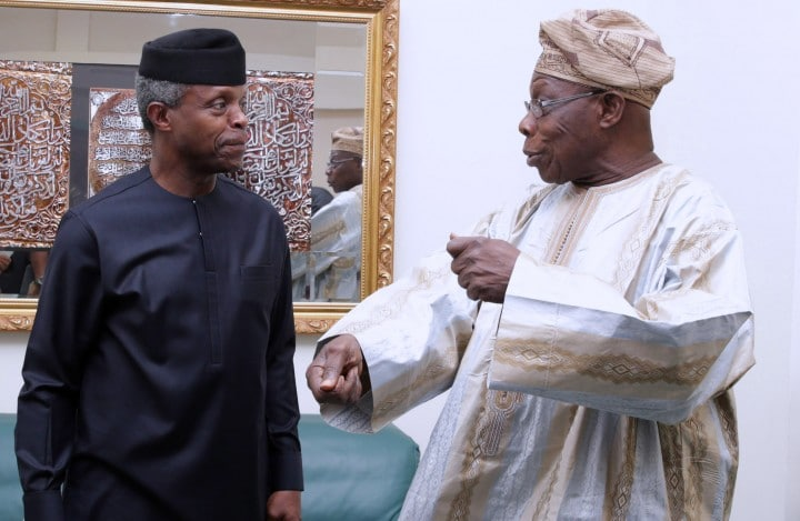 AG PRESIDENT OSINBAJO ATTENDS BIAFRA@50YRS AFTER FORUM. 1A&B. R-L; Former President Chief Olusegun Obasanjo chats with Acting President Yemi Osinbajo at a fourm on Biafra 50 Years after held at the Shehu Musa Yar'Adua Centre in Abuja. PHOTO; SUNDAY AGHAEZE. MAY 25 2017