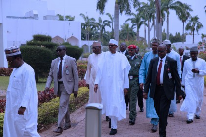 JUMA'AT 0A. President Muhammadu Buhari (M) on his way to the mosque with aides for the Juma'at prayers. PHOTO; SUNDAY AGHAEZE. MAY 5 2017