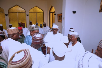 JUMA'AT President Muhammadu Buhari in the mosque exchanging greeting during the Juma'at prayers. PHOTO; SUNDAY AGHAEZE. MAY 5 2017