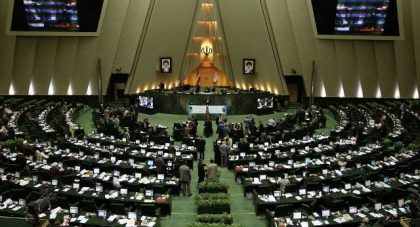 U.S flag burnt by Iranian hardliners , copy of nuclear deal in parliament
