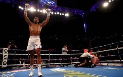 Anthony Joshua KOs Alexander Povetkin to retain world heavyweight titles